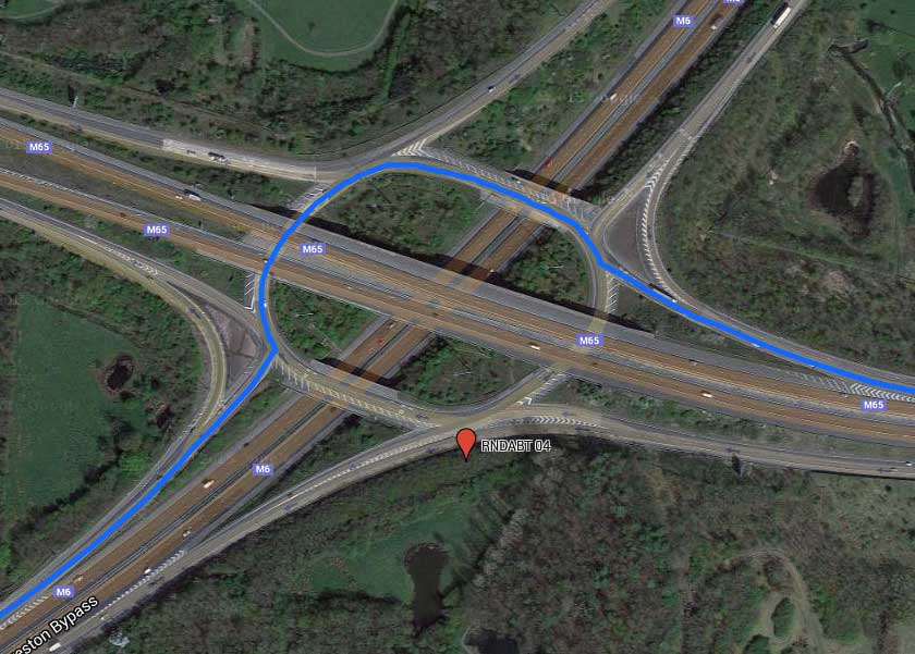 A giant roundabout is essentially a cloverleaf. Some roundabouts are so large you don't even realize you're in one.